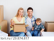 Купить «happy family with boxes moving to new home», фото № 29874817, снято 25 февраля 2016 г. (c) Syda Productions / Фотобанк Лори
