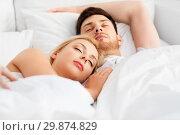 Купить «happy couple sleeping in bed at home», фото № 29874829, снято 25 февраля 2016 г. (c) Syda Productions / Фотобанк Лори