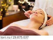 Купить «beautician applying facial mask to woman at spa», фото № 29875037, снято 26 января 2017 г. (c) Syda Productions / Фотобанк Лори