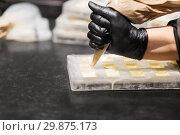 Купить «confectioner filling mold by cream at pastry shop», фото № 29875173, снято 4 декабря 2018 г. (c) Syda Productions / Фотобанк Лори