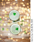 Купить «glasses of green beer with shamrock from top», фото № 29875181, снято 31 января 2018 г. (c) Syda Productions / Фотобанк Лори