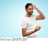 Купить «indian man applying hair wax or styling gel», фото № 29875201, снято 27 октября 2018 г. (c) Syda Productions / Фотобанк Лори