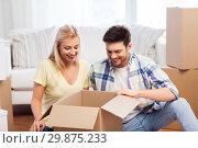 Купить «happy couple unpacking boxes at new home», фото № 29875233, снято 25 февраля 2016 г. (c) Syda Productions / Фотобанк Лори