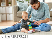 Купить «father playing with little baby daughter at home», фото № 29875281, снято 25 августа 2018 г. (c) Syda Productions / Фотобанк Лори