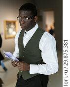 Купить «Afro man visiting exposition», фото № 29875381, снято 19 января 2019 г. (c) Яков Филимонов / Фотобанк Лори
