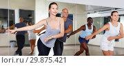 Купить «Cheerful people practicing vigorous lindy hop movements in dance class», фото № 29875421, снято 30 июля 2018 г. (c) Яков Филимонов / Фотобанк Лори