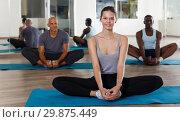 Купить «Group of active young people practicing stretching workout», фото № 29875449, снято 30 июля 2018 г. (c) Яков Филимонов / Фотобанк Лори