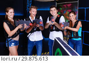Купить «Group portrait of joyful young people with laser guns in their h», фото № 29875613, снято 27 августа 2018 г. (c) Яков Филимонов / Фотобанк Лори