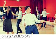 Купить «Glad group people dancing lindy hop in pairs», фото № 29875645, снято 24 мая 2017 г. (c) Яков Филимонов / Фотобанк Лори