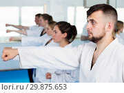 Купить «Adults trying new martial moves at karate class», фото № 29875653, снято 8 апреля 2017 г. (c) Яков Филимонов / Фотобанк Лори