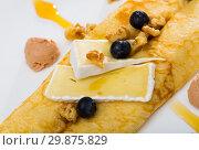 Delicious pancakes with cheese Brie, walnuts and foie gras. Стоковое фото, фотограф Яков Филимонов / Фотобанк Лори