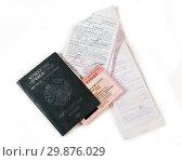 Купить «Паспорт, патент, миграционная карта и чеки трудового мигранта из Таджикистана в России», фото № 29876029, снято 22 апреля 2019 г. (c) Светлана Кузнецова / Фотобанк Лори
