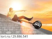 Купить «Student in loan and expensive education concept», фото № 29886541, снято 19 марта 2019 г. (c) Elnur / Фотобанк Лори
