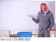 Купить «Young handsome arab teacher wearing suit», фото № 29886929, снято 21 ноября 2018 г. (c) Elnur / Фотобанк Лори