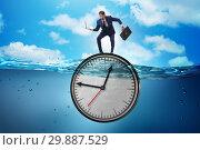 Купить «Businessman in deadline and time management concept», фото № 29887529, снято 19 марта 2019 г. (c) Elnur / Фотобанк Лори