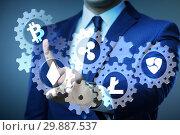 Купить «Concept of cryptocurrencies with man pressing buttons», фото № 29887537, снято 25 мая 2020 г. (c) Elnur / Фотобанк Лори