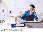 Купить «Male sales analyst in front of the whiteboard», фото № 29888845, снято 20 октября 2018 г. (c) Elnur / Фотобанк Лори