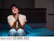 Купить «Man can not sleep due to noise neighbor», фото № 29889433, снято 18 сентября 2018 г. (c) Elnur / Фотобанк Лори