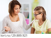 Купить «upset mother talking to daughter doing homework», фото № 29889921, снято 7 октября 2018 г. (c) Syda Productions / Фотобанк Лори