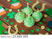 Купить «green cupcakes and st patricks day party props», фото № 29889989, снято 31 января 2018 г. (c) Syda Productions / Фотобанк Лори
