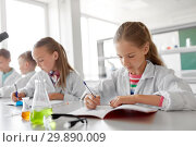 Купить «kids studying chemistry at school laboratory», фото № 29890009, снято 19 мая 2018 г. (c) Syda Productions / Фотобанк Лори