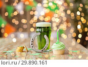 Купить «glass of beer, cupcake, horseshoe and gold coins», фото № 29890161, снято 31 января 2018 г. (c) Syda Productions / Фотобанк Лори
