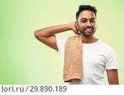 Купить «smiling indian man with towel over green», фото № 29890189, снято 27 октября 2018 г. (c) Syda Productions / Фотобанк Лори