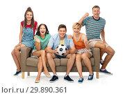 Купить «friends or football fans with soccer ball on sofa», фото № 29890361, снято 30 июня 2018 г. (c) Syda Productions / Фотобанк Лори