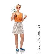 Купить «teenager with badminton rackets and shuttlecock», фото № 29890373, снято 30 июня 2018 г. (c) Syda Productions / Фотобанк Лори