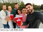 Купить «friends with drinks taking selfie at rooftop party», фото № 29890433, снято 2 сентября 2018 г. (c) Syda Productions / Фотобанк Лори