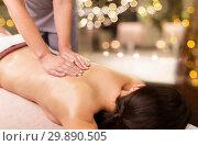Купить «woman lying and having back massage at spa parlor», фото № 29890505, снято 26 января 2017 г. (c) Syda Productions / Фотобанк Лори
