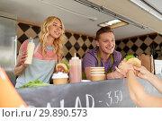 Купить «happy sellers serving customers at food truck», фото № 29890573, снято 1 августа 2017 г. (c) Syda Productions / Фотобанк Лори