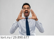 Купить «indian businessman screaming over grey», фото № 29890677, снято 12 января 2019 г. (c) Syda Productions / Фотобанк Лори