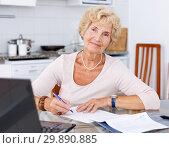 Купить «Mature woman filling up documents», фото № 29890885, снято 11 июля 2018 г. (c) Яков Филимонов / Фотобанк Лори