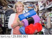 Купить «mature woman purchaser holding cotton plaids», фото № 29890961, снято 29 ноября 2017 г. (c) Яков Филимонов / Фотобанк Лори
