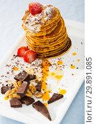 Купить «Pancakes served with fruit, honey, chocolate and whipped cream», фото № 29891085, снято 23 марта 2019 г. (c) Яков Филимонов / Фотобанк Лори