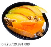Breakfast with pumpkin and mango served with whipped topping and oat flakes. Стоковое фото, фотограф Яков Филимонов / Фотобанк Лори