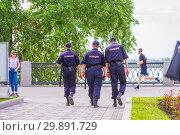 Купить «Russia, Samara, May 2018: Police patrol officers patrol the embankment. Russian text: Police», фото № 29891729, снято 24 мая 2018 г. (c) Акиньшин Владимир / Фотобанк Лори