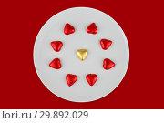 Купить «Abstract chocolate candies in hearts shape on white plate», фото № 29892029, снято 5 февраля 2019 г. (c) Kira_Yan / Фотобанк Лори