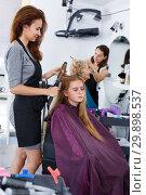 Купить «Hairdresser curling hair of girl», фото № 29898537, снято 26 июня 2018 г. (c) Яков Филимонов / Фотобанк Лори