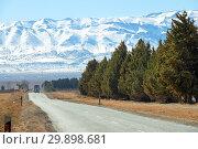 Купить «Road leading to snow Atlas mountains», фото № 29898681, снято 15 февраля 2018 г. (c) Михаил Коханчиков / Фотобанк Лори