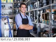 Купить «Portrait of smiling male in uniform in workshop», фото № 29898981, снято 26 июля 2017 г. (c) Яков Филимонов / Фотобанк Лори