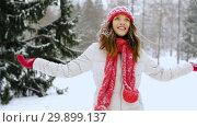 Купить «happy young woman in winter forest», видеоролик № 29899137, снято 31 января 2019 г. (c) Syda Productions / Фотобанк Лори