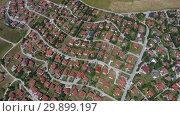 Купить «Aerial view of houses in Zlatibor, Serbia», видеоролик № 29899197, снято 6 января 2019 г. (c) Михаил Коханчиков / Фотобанк Лори