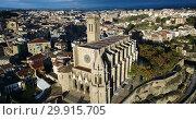 Купить «Aerial view of Manresa town with Basilica de Santa Maria, Catalonia, Spain», видеоролик № 29915705, снято 24 декабря 2018 г. (c) Яков Филимонов / Фотобанк Лори