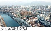 Купить «Aerial view Grenoble of city center with embankment of Isere river, France», видеоролик № 29915729, снято 5 января 2019 г. (c) Яков Филимонов / Фотобанк Лори