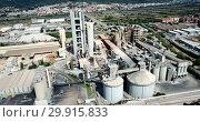 Купить «Aerial view of cement production plant», видеоролик № 29915833, снято 26 августа 2018 г. (c) Яков Филимонов / Фотобанк Лори