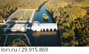 Купить «Aerial view of Chateau de Chenonceau in Loire valley, France», видеоролик № 29915869, снято 25 октября 2018 г. (c) Яков Филимонов / Фотобанк Лори