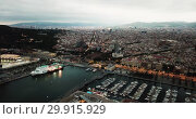 Купить «Night aerial view from drones of old port in Barcelona with of sailboats and yachts and gothic quarter, historical part of the city», видеоролик № 29915929, снято 1 сентября 2018 г. (c) Яков Филимонов / Фотобанк Лори
