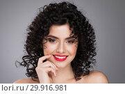 Купить «Smiling woman with curls hairstyle», фото № 29916981, снято 18 апреля 2017 г. (c) Иван Михайлов / Фотобанк Лори